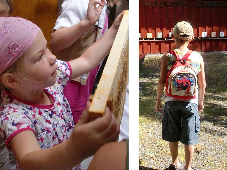 Kinder bestaunen den Lehrbienenstand